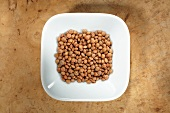 Mountain lentils in dish from above