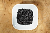 Beluga lentils in dish from above