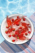 Strawberry lemonade in bottles on ice