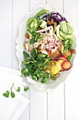 Salad of plums, smoked chicken breast, vegetables and watercress