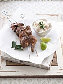 Chicken with green curry on skewer with rice