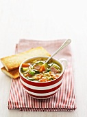 Noodle and vegetable soup with bacon