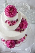 Three-tier wedding cake decorated with flowers