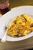 Ribbon pasta with pumpkin and rosemary