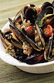 Mussels with sausagemeat and cherry tomatoes
