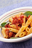 Penne all'amatriciana (pasta with tomatoes, bacon and onions)