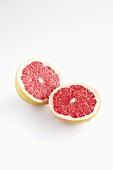 Halved pink grapefruit