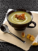 Cream of pea soup with fried Parma ham