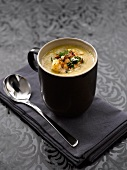 Celeriac, leek and orange soup with toasted almonds and fried lobster