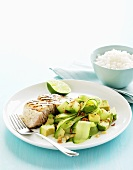 Grilled fillet of fish with an avocado and cucumber salad