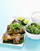 Barbecued chicken thighs with wild herb salad and lime juice