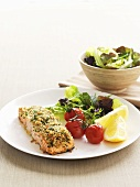 Salmon in herb and breadcrumb crust with baked tomatoes
