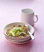 Muesli with yogurt and kiwi sauce