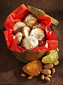 Iced gingerbread with almonds in biscuit box