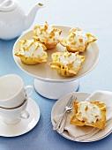 Several individual lemon meringue pies