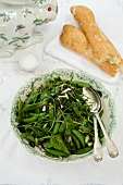 Green salad with sugar snap peas and baby spinach