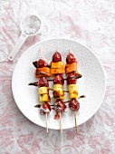 Grilled fruit kebabs with passion fruit glaze and chilli chocolate sauce