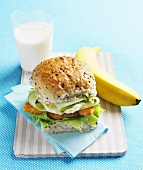 Schnitzel burger, banana and glass of milk