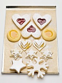 Assorted jam biscuits and cinnamon star on baking tray