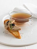 Spiced duck tea with duck liver crostini