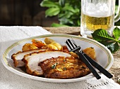 Roast pork with crackling with vegetables and beer