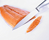Salmon with filleting knife