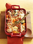 Pumpkin and courgette gratin in baking dish
