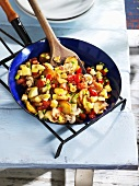 Fried potatoes with vegetables and button mushrooms