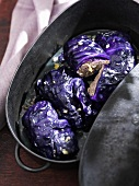 Stuffed red cabbage leaves in roasting tin