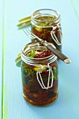 Dried tomatoes preserved in oil with garlic and thyme