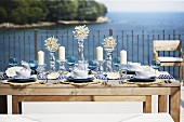 A table laid on a terrace overlooking the sea
