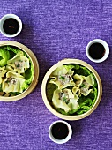 Wontons with pork and savoy cabbage in bamboo steamers