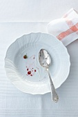 An empty plate with leftover woodland strawberries