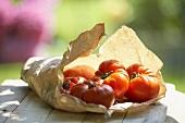 Tomatoes, variety 'Vierländer Krause', on paper bag