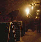 Several riddling racks in a wine cellar