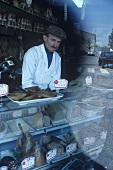 Butcher behind counter, Pauillac, France