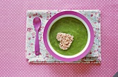Asparagus puree with heart-shaped piece of ham