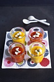 Cream of red and yellow pepper soup with soft cheese in glasses