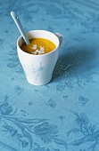 Carrot soup with ginger and coconut milk in cup