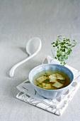 Herb soup with ravioli