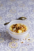 Apple and pear soup with toasted rolled oats and maple syrup