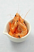 Cooked prawns in a porcelain bowl