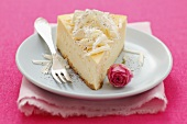 Cheesecake with white chocolate flakes and a rose