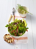 Mixed salad with avocado and prawns