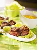 Beef kebabs on lettuce leaves