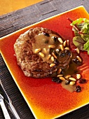 Beef medallion with a pine nut and raisin sauce