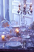 A table laid with glass crockery for Christmas