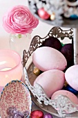 Easter eggs and sweets on a cake stand