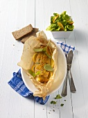 Fillet of char with oranges in parchment paper