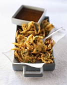 Fried onions with gravy